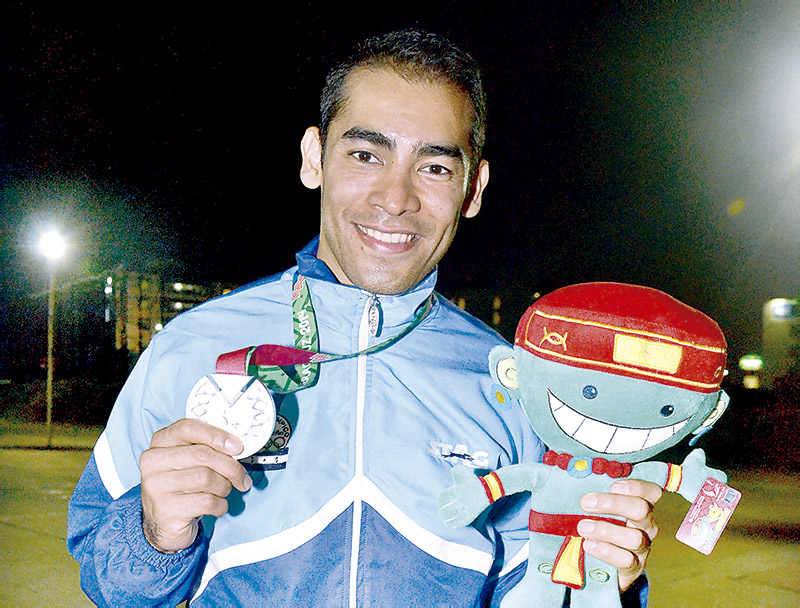 Miguel Ferrera abrió camino de las medallas en Veracruz 2014.